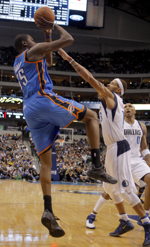 Oklahoma City's Kevin Durant (35) shoots over Dallas' Delonte West  during the pre season NBA game between the Dallas Mavericks and the Oklahoma City Thunder at the American Airlines Center in Dallas, Sunday, Dec. 18, 2011. Photo by Sarah Phipps, The Oklahoman