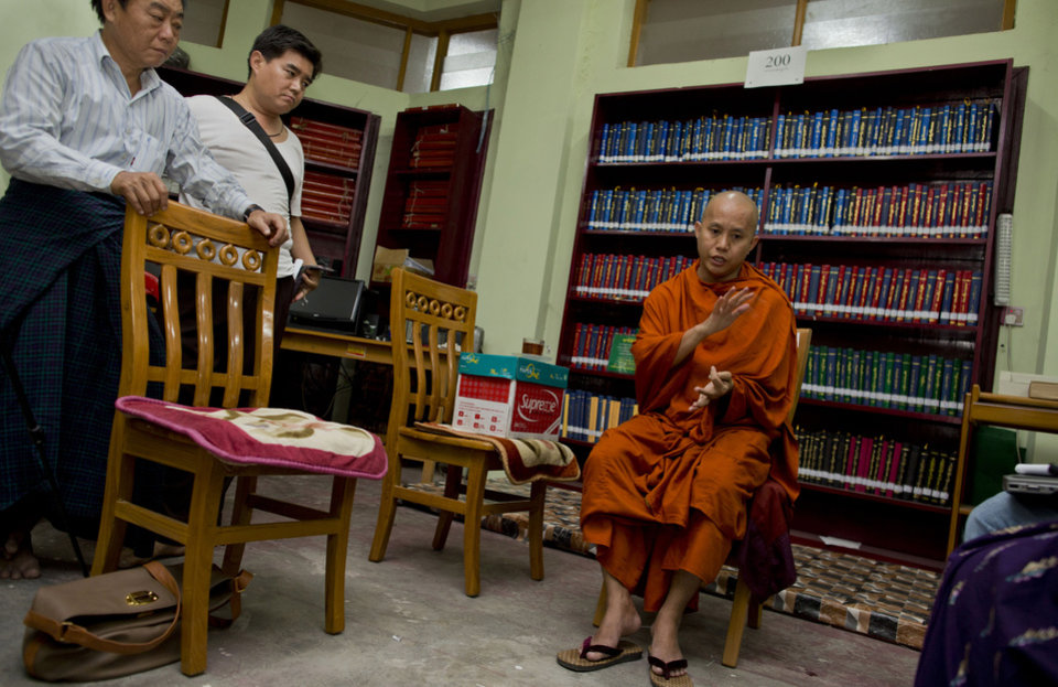 Photo - In this photo taken on March 27, 2013, Buddhist monk Wirathu, right, speaks during an interview at Ma Soe Yein monastery in Mandalay, Myanmar. Wirathu and others insist