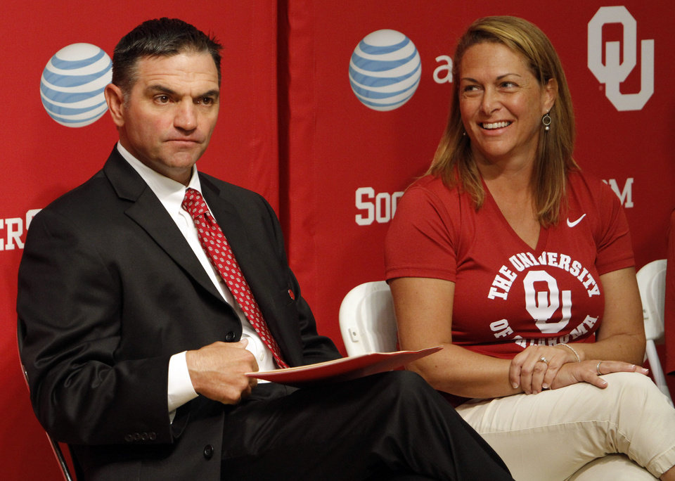 Photo - Debby Hughes looks at her husband Pete before his introduction as the University of Oklahoma (OU) Sooners new baseball coach on Thursday, June 27, 2013 in Norman, Okla. Photo by Steve Sisney, The Oklahoman