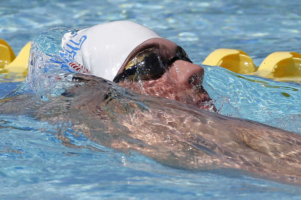 Photo - Michael Phelps warms up prior to competing in the 100-meter butterfly during the Arena Grand Prix swim meet, Thursday, April 24, 2014, in Mesa, Ariz. It is Phelps' first competitive event after a nearly two-year retirement. (AP Photo/Matt York)