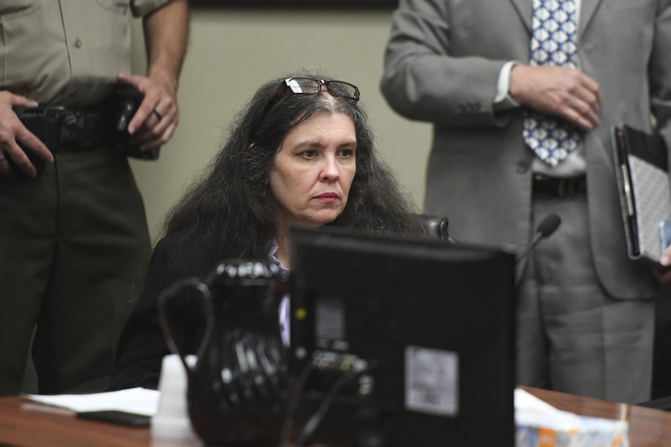 Photo -  Louise Turpin sits in a courtroom during a sentencing hearing Friday, April 19, 2019, in Riverside, Calif. Turpin and her husband, David, who pleaded guilty to years of torture and abuse of 12 of their 13 children have been sentenced to life in prison with possibility of parole after 25 years. (Will Lester/The Orange County Register via AP, Pool)