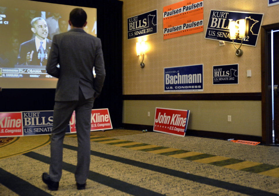 Photo -   Matt Nyman, of Minneapolis, watches a broadcast of President Barack Obama's victory speech at the Minnesota Republican Election headquarters in Bloomington, Minn., Wed., Nov. 7, 2012. (AP Photo/Tom Olmscheid)