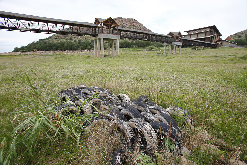 Photo - Drought. Fish habitat made of tires lies in a dried up neck at the Quartz Mountain Conference Center on Lake Altus-Lugert near Altus,  June 30, 2014.   Photo by David McDaniel, The Oklahoman