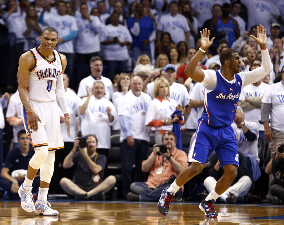 Photo - Oklahoma City's Russell Westbrook (0) celebrates after he if folded by Los Angeles' Chris Paul (3) on a 3-point shot in the late in the fourth quarter during Game 5 of the Western Conference semifinals in the NBA playoffs between the Oklahoma City Thunder and the Los Angeles Clippers at Chesapeake Energy Arena in Oklahoma City, Tuesday, May 13, 2014. Photo by Sarah Phipps, The Oklahoman