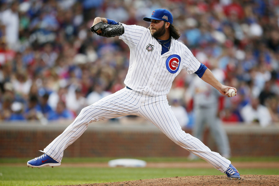 Photo - Chicago Cubs relief pitcher James Russell delivers against the St. Louis Cardinals during the seventh inning of a baseball game on Saturday, July 26, 2014, in Chicago. (AP Photo/Andrew A. Nelles)