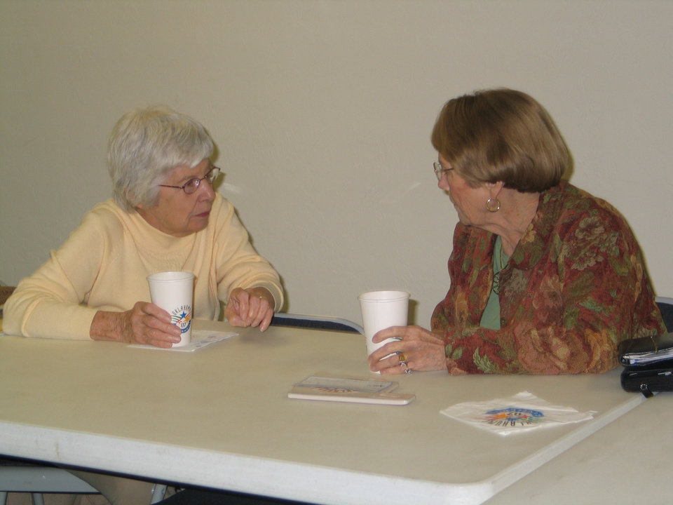 Ruthann Wilson and Shirley Thompson discuss plans for the Society's Christmas dinner at the Harrah Historical Society's Centennial Celebration, November 15<br/><b>Community Photo By:</b> Karen Erbin, editor<br/><b>Submitted By:</b> Karen, Harrah