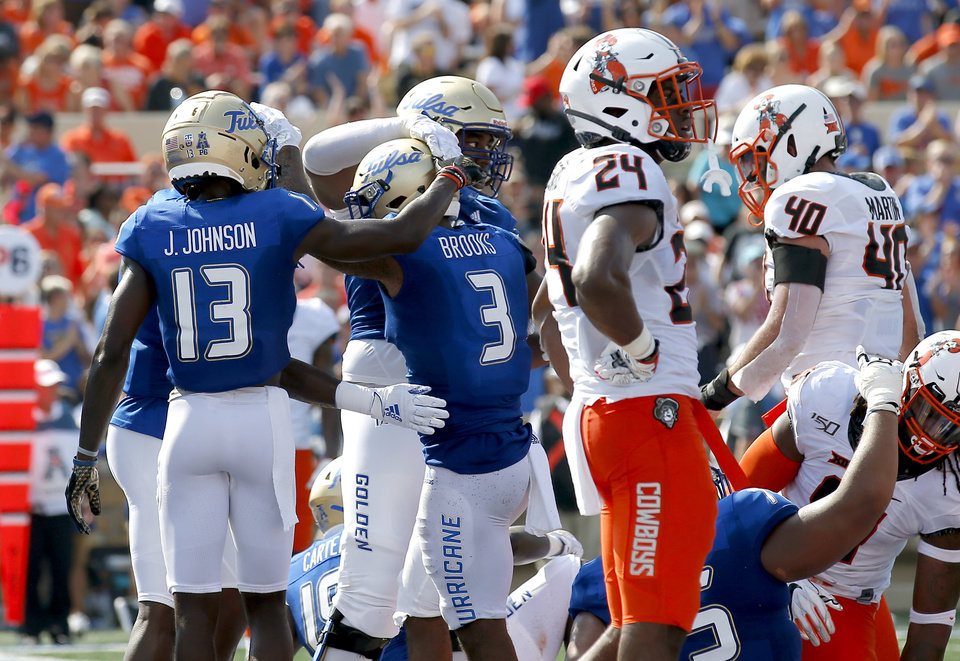 Photo - Tulsa celebrates the score of Tulsa's Shamari Brooks (3) as Oklahoma State's Jarrick Bernard (24) reacts in the second quarter during a college football game between the Oklahoma State University Cowboys (OSU) and the University of Tulsa Golden Hurricane (TU) at H.A. Chapman Stadium in Tulsa, Okla., Saturday, Sept. 14, 2019. [Sarah Phipps/The Oklahoman]