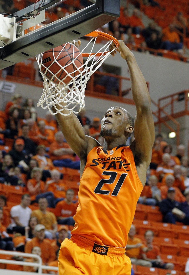 Oklahoma State's Kamari Murphy (21) dunks during the men's college basketball game between Oklahoma State University and Central Arkansas at Gallagher-Iba Arena in Stillwater, Okla., Sunday,Dec. 16, 2012. Photo by Sarah Phipps, The Oklahoman