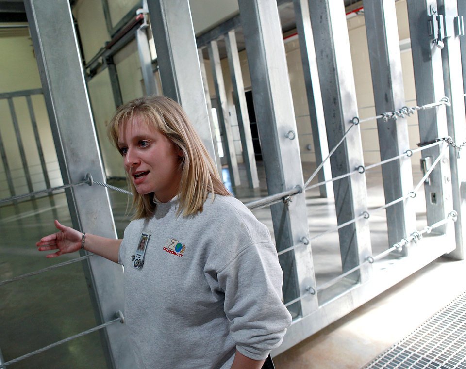 Jennifer D'Agostino, Director of Veterinary Services at the Oklahoma City Zoo, talks about Asha's care and pregnancy on Tuesday, April 5, 2011. Asha, who's due date is getting closer, will give birth in this enclosure inside the new Elephant Exhibit at the Zoo. Photo by John Clanton, The Oklahoman ORG XMIT: KOD