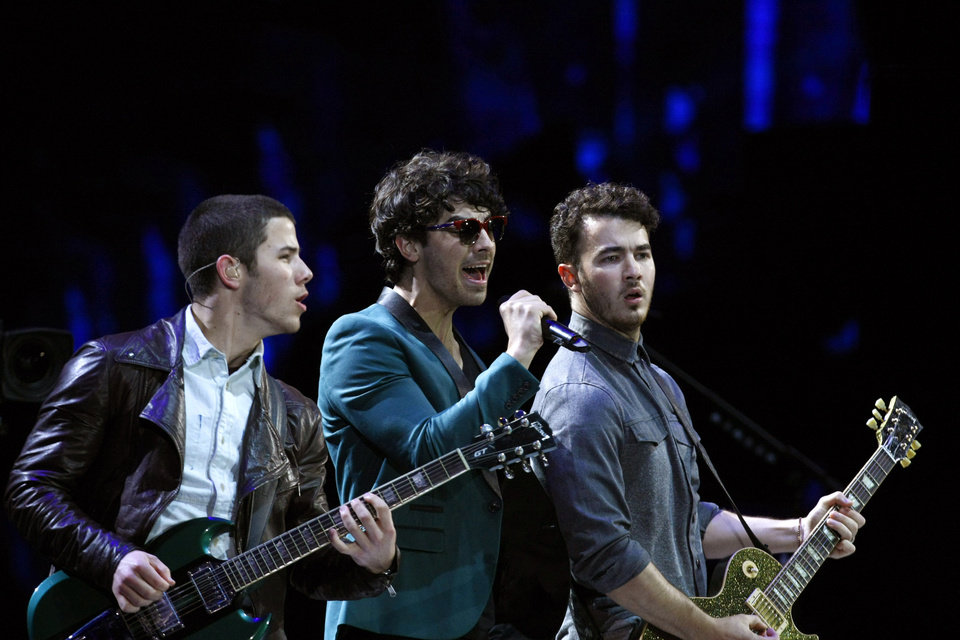 Photo -  The Jonas Brothers, perform at the Vina del Mar International Song Festival in Vina del Mar, Chile, Tuesday, Feb. 26, 2013. Believed to be one of the largest musical events in Latin America, the annual 5-day festival was inaugurated in 1960. (AP Photo/Luis Hidalgo)