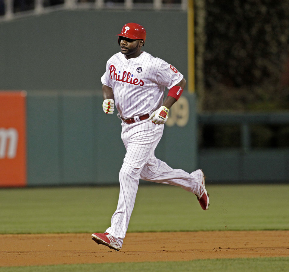 Photo - Philadelphia Phillies' Ryan Howard (6) runs the bases after hitting a solo home run against the Atlanta Braves in the second inning of  the MLB National League baseball game Monday, April 14, 2014, in Philadelphia.  (AP Photo/H. Rumph Jr)