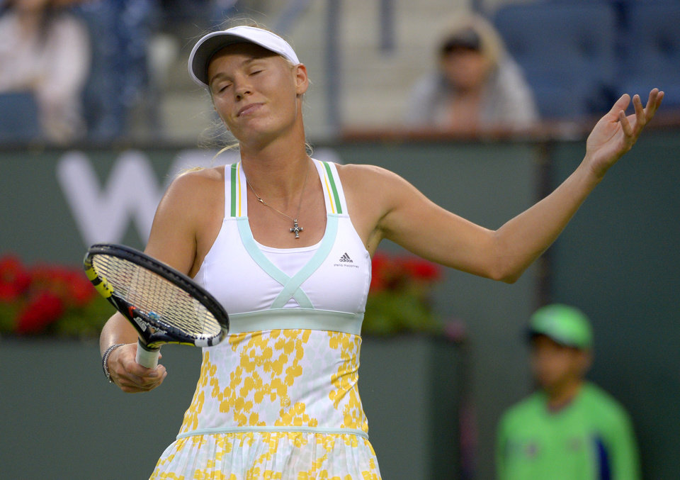 Photo - Caroline Wozniacki, of Denmark, reacts to losing a point to Bojana Jovanovski, of Serbia, during a second-round match at the BNP Paribas Open tennis tournament on Friday, March 7, 2014, in Indian Wells, Calif. (AP Photo/Mark J. Terrill)