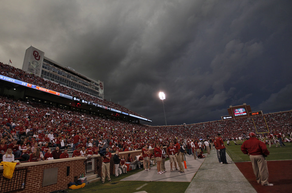 Storm clouds build before the start of the  college football game between the University of Oklahoma Sooners (OU) and Texas Tech University Red Raiders (TTU) at the Gaylord Family-Oklahoma Memorial Stadium on Saturday, Oct. 22, 2011. in Norman, Okla. Photo by Chris Landsberger, The Oklahoman
