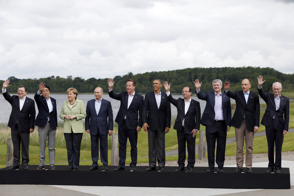 Photo - G-8 leaders from left, European Commission President Jose Manuel Barroso, Japan's Prime Minister Shinzo Abe, German Chancellor Angela Merkel, Russian President Vladimir Putin, British Prime Minister David Cameron, US President Barack Obama, French President Francois Hollande, Canadian Prime Minister Stephen Harper, Italian Prime Minister Enrico Letta and European Council President Herman Van Rompuy pose during a group photo opportunity during the G-8 summit at the Lough Erne golf resort in Enniskillen, Northern Ireland, on Tuesday, June 18, 2013. The final day of the G-8 summit of wealthy nations is ending with discussions on globe-trotting corporate tax dodgers, a lunch with leaders from Africa, and suspense over whether Russia and Western leaders can avoid diplomatic fireworks over their deadlock on Syria's civil war. (AP Photo/Lefteris Pitarakis)
