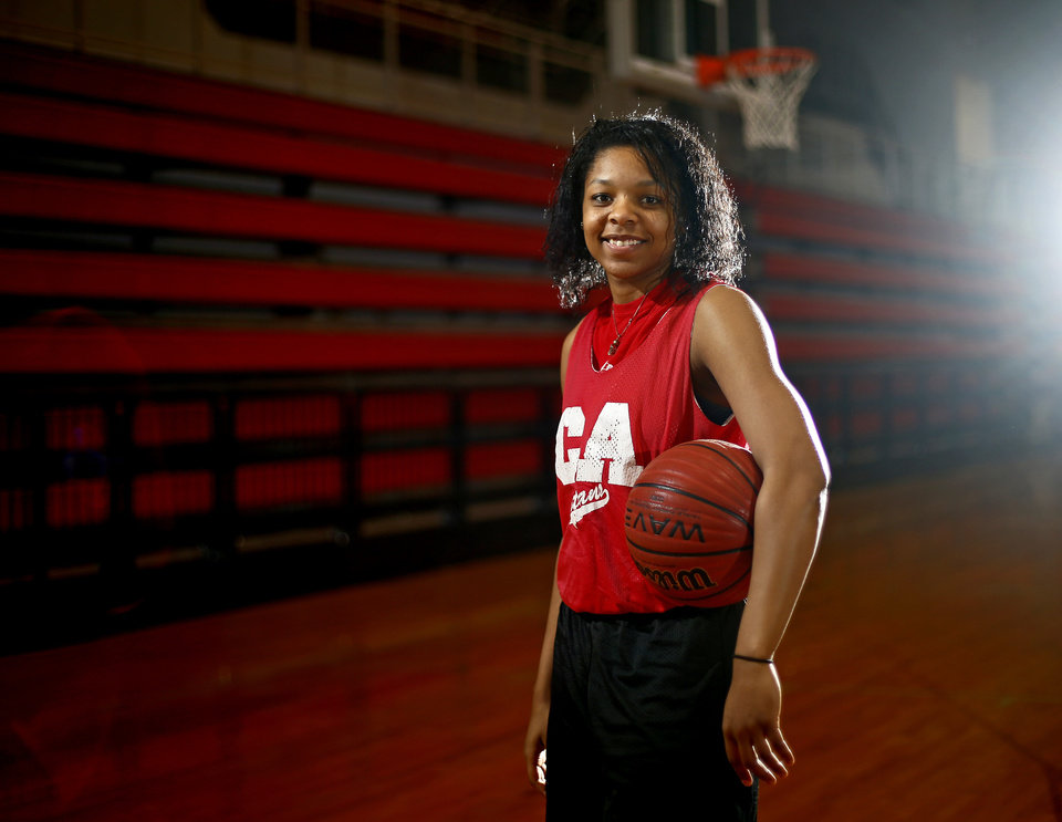 Photo - GIRLS HIGH SCHOOL BASKETBALL: Carl Albert basketball player Gioya Carter poses for a portrait inside the Carl Albert High School gym on Midwest City, Wednesday, Jan. 31, 2013. Photo by Bryan Terry, The Oklahoman