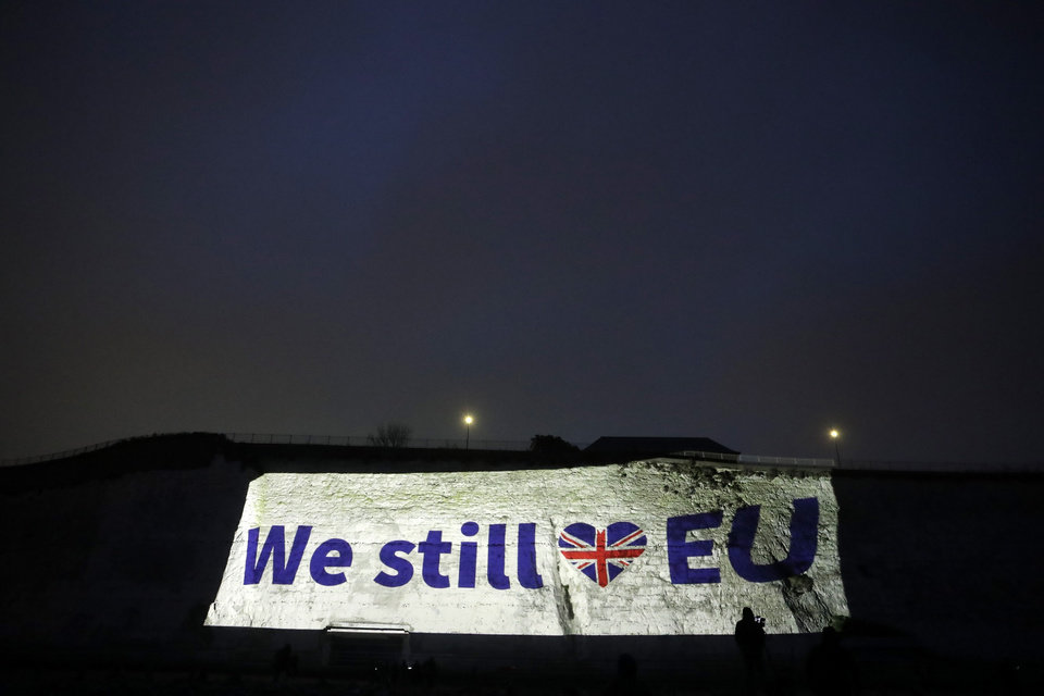 Photo -  A projection appears on a cliff in Ramsgate, southern England, Friday, Jan. 31, 2020. Britain officially leaves the European Union on Friday after a debilitating political period that has bitterly divided the nation since the 2016 Brexit referendum. (AP Photo/Matt Dunham)