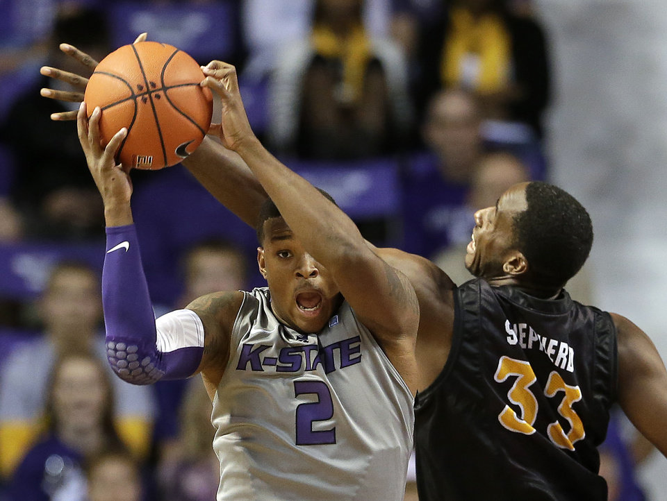 Photo - Kansas State's Marcus Foster (2) beats Long Beach State's Nick Shepherd (33) to a rebound during the first half of an NCAA college basketball game Sunday, Nov. 17, 2013, in Manhattan, Kan. (AP Photo/Charlie Riedel)