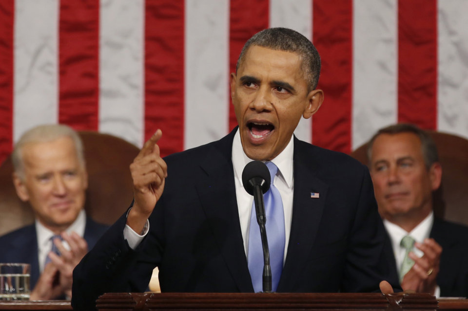 Photo - President Barack Obama delivers the State of Union address before a joint session of Congress in the House chamber Tuesday, Jan. 28, 2014, in Washington, as Vice President Joe Biden, and House Speaker John Boehner of Ohio, listen. (AP Photo/Larry Downing, Pool)