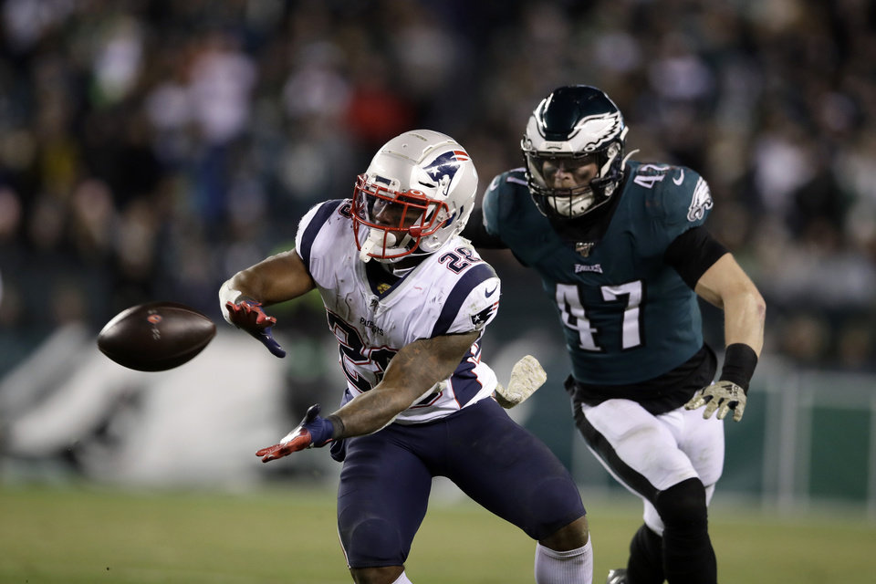Photo - New England Patriots' James White (28) catches a pass against Philadelphia Eagles' Nate Gerry (47) during the second half of an NFL football game, Sunday, Nov. 17, 2019, in Philadelphia. (AP Photo/Matt Rourke)