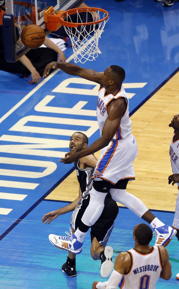Photo - Oklahoma City's Serge Ibaka (9) defends against San Antonio's Tony Parker (9) during Game 3 of the Western Conference Finals in the NBA playoffs between the Oklahoma City Thunder and the San Antonio Spurs at Chesapeake Energy Arena in Oklahoma City, Sunday, May 25, 2014. Photo by Nate Billings, The Oklahoman