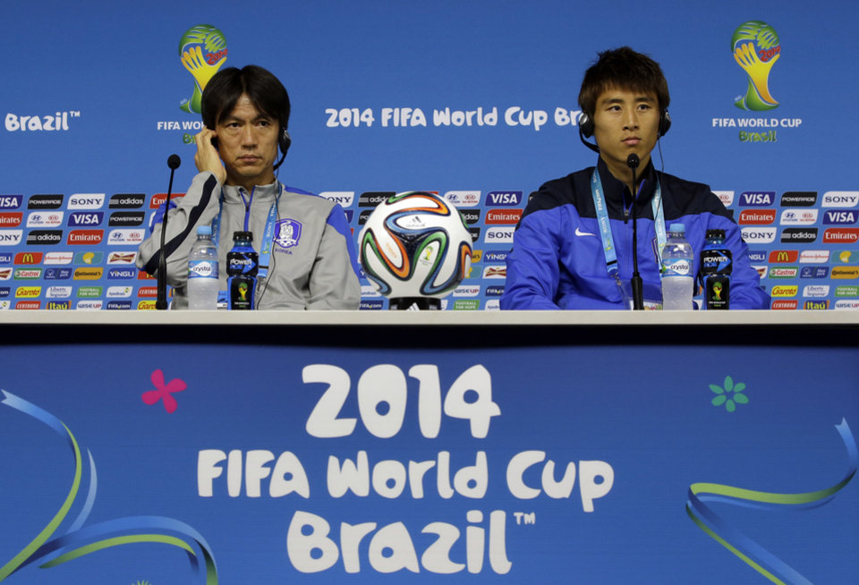 Photo - South Korea national soccer team coach Hong Myung-bo, left, and team captain Koo Ja-cheol listen to reporter's question during a press conference the day before the group H World Cup soccer match between South Korea and Belgium at the Itaquerao Stadium in Sao Paulo, Brazil, Wednesday, June 25, 2014.  (AP Photo/Lee Jin-man)