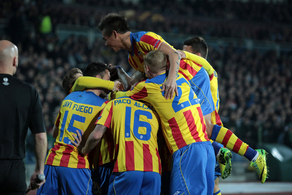 Photo - Valencia players celebrate after scoring their first goal against Ludogorets during their Europa League round of 16 first leg soccer match at Vassil Levski stadium in Sofia, Thursday, March 13, 2014. (AP Photo/Valentina Petrova)