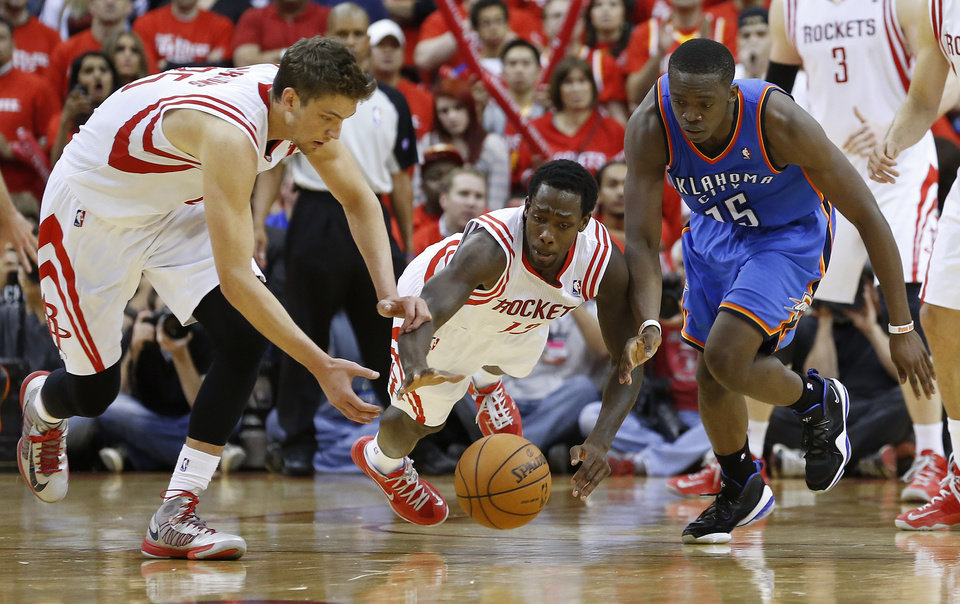 Photo - Oklahoma City's Reggie Jackson (15) goes for the ball beside Houston's Chandler Parsons (25), and Patrick Beverley (12) during Game 6 in the first round of the NBA playoffs between the Oklahoma City Thunder and the Houston Rockets at the Toyota Center in Houston, Texas, Friday, May 3, 2013. Oklahoma City won 103-94. Photo by Bryan Terry, The Oklahoman