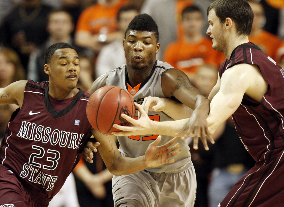 OSU\'s Marcus Smart (33) tries to steal the ball from Christian Kirk (42) of Missouri State as he passes to Dorrian Williams (23) during a men\'s college basketball between Oklahoma State University and Missouri State at Gallagher-Iba Arena in Stillwater, Okla., Saturday, Dec. 8, 2012. Photo by Nate Billings, The Oklahoman