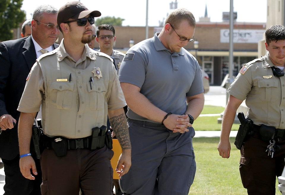 Photo - John Robert Markus is led away from the Garfield County Courthouse in Enid, Okla., Tuesday, July 25, 2017, after being indicted in connection with the death of an inmate. Photo by Bryan Terry, The Oklahoman