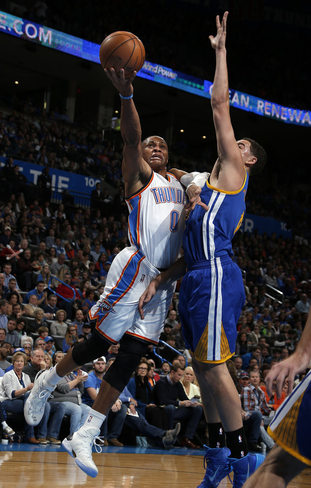 Oklahoma City's Russell Westbrook (0) shoots a lay up as Golden State's Klay Thompson (11) defends during the NBA game between the Oklahoma City Thunder and the Golden State Warriors at the Chesapeake Energy Arena, Friday, Nov. 29, 2013. Photo by Sarah Phipps, The Oklahoman