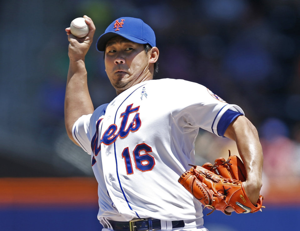 Photo - New York Mets' Daisuke Matsuzaka delivers during the first inning of a baseball game against the San Diego Padres in New York, Sunday, June 15, 2014. (AP Photo/Kathy Willens)