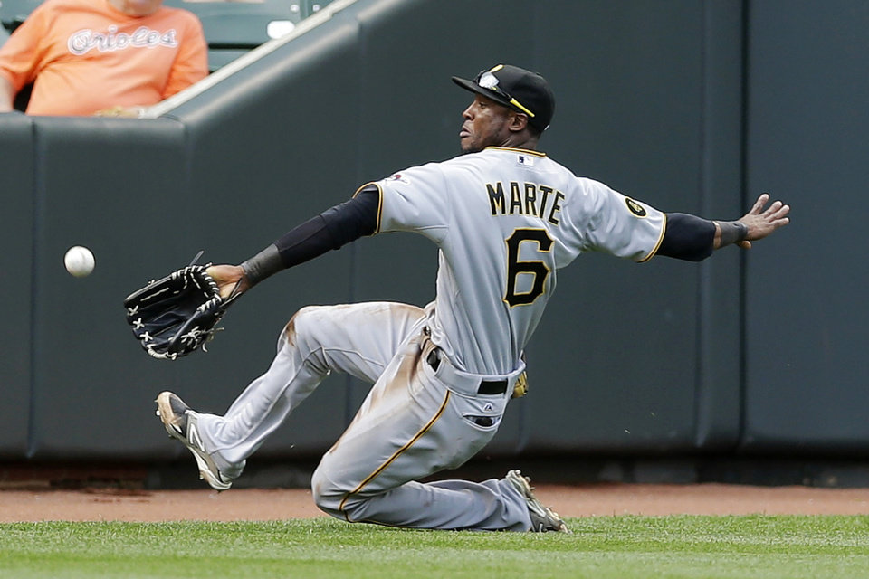 Photo - Pittsburgh Pirates left fielder Starling Marte reaches but can't catch Baltimore Orioles' Steve Clevenger's fly ball in the second inning in the first baseball game of a doubleheader, Thursday, May 1, 2014, in Baltimore. Clevenger doubled on the play. (AP Photo/Patrick Semansky)