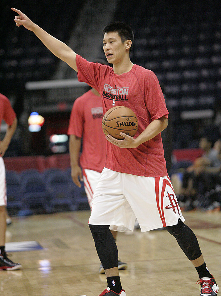 Photo - Houston Rockets guard Jeremy Lin points to his teammates during a shoot-around before the Rockets' NBA preseason basketball game against the Oklahoma City Thunder in Hidalgo, Texas, Wednesday, Oct. 10, 2012. (AP Photo/Delcia Lopez) ORG XMIT: TXDL101