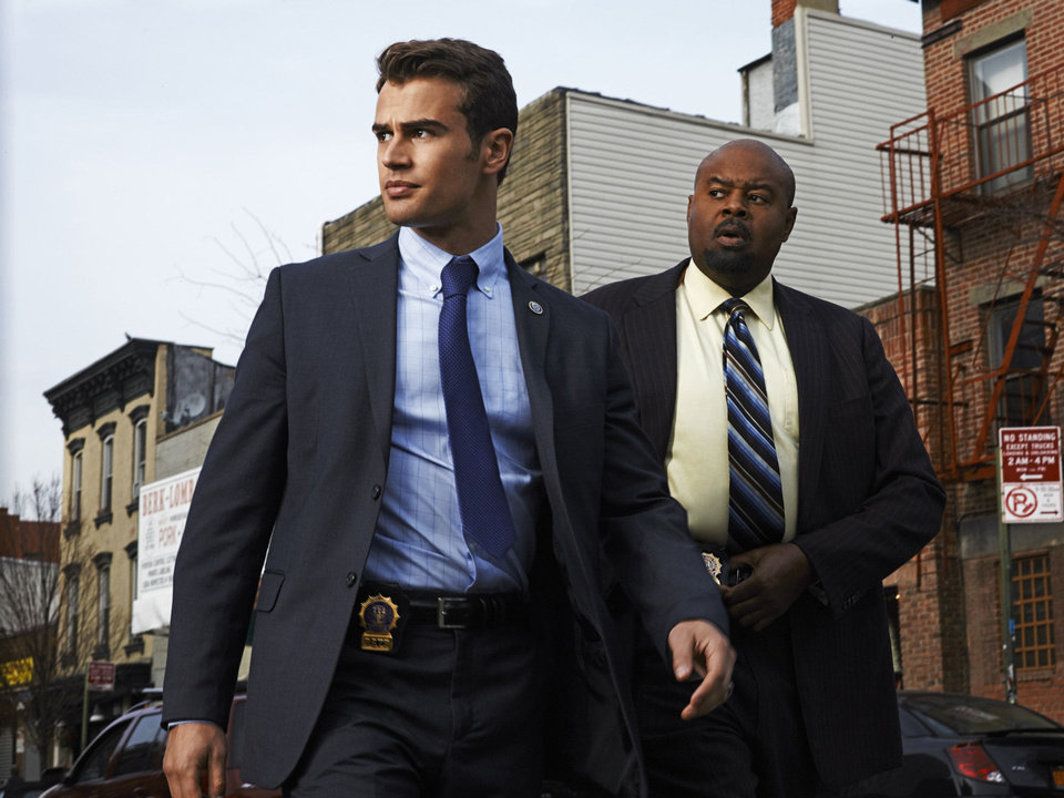 Photo - Walter Clark Jr. (Theo James, left) is partnered with and mentored by experienced veteran Detective Don Owen (Chi McBride, right) in the new CBS drama GOLDEN BOY. GOLDEN BOY, premieres Tuesday, February 26 (10:00 – 11:00 PM, ET/PT), with a special sneak peak episode, on the CBS Television Network. This photo is provided for use in conjunction with the TCA WINTER PRESS TOUR 2012.  Photo: Warwick Saint/CBS  ©2013 CBS Broadcasting Inc. All Rights Reserved
