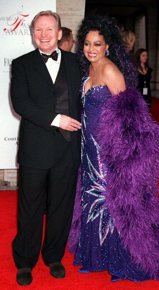 "Photo -  FOR USE WITH AP WEEKLY FEATURES -- Designer Bob Mackie arrives with Diana Ross at New York's Lincoln Center for the 20th Annual American Fashion Awards Thursday, June 14, 2001. Ross presented Mackie a ""special award for his fashion exuberance"" from the Council of Fashion Designers of America. (AP Photo/Darla Khazei)"