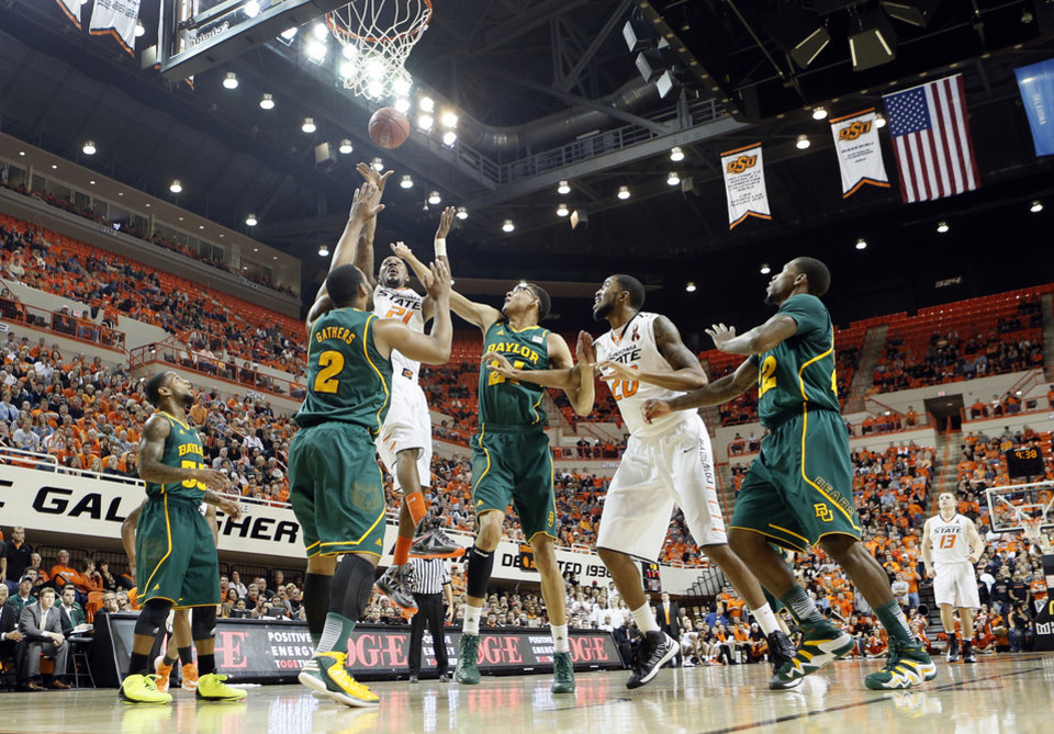 Oklahoma State 's Kamari Murphy (21) shoots over Baylor's Rico Gathers (2) and Isaiah Austin (21) during the college basketball game between the Oklahoma State University Cowboys (OSU) and the Baylor University Bears (BU) at Gallagher-Iba Arena on Wednesday, Feb. 5, 2013, in Stillwater, Okla. Photo by Chris Landsberger, The Oklahoman