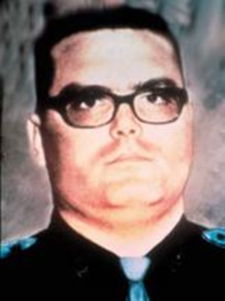 Photo - OKLAHOMA HIGHWAY PATROL / MUG: Trooper Larry Smith  Smith joined the OHP in 1970.  Trooper Smith was making an emergency response to a reported burglary near Tonkawa when a seventeen-year-old driver made a left turn in front of his unit on United States Highway 60. Both drivers were killed in the collision.