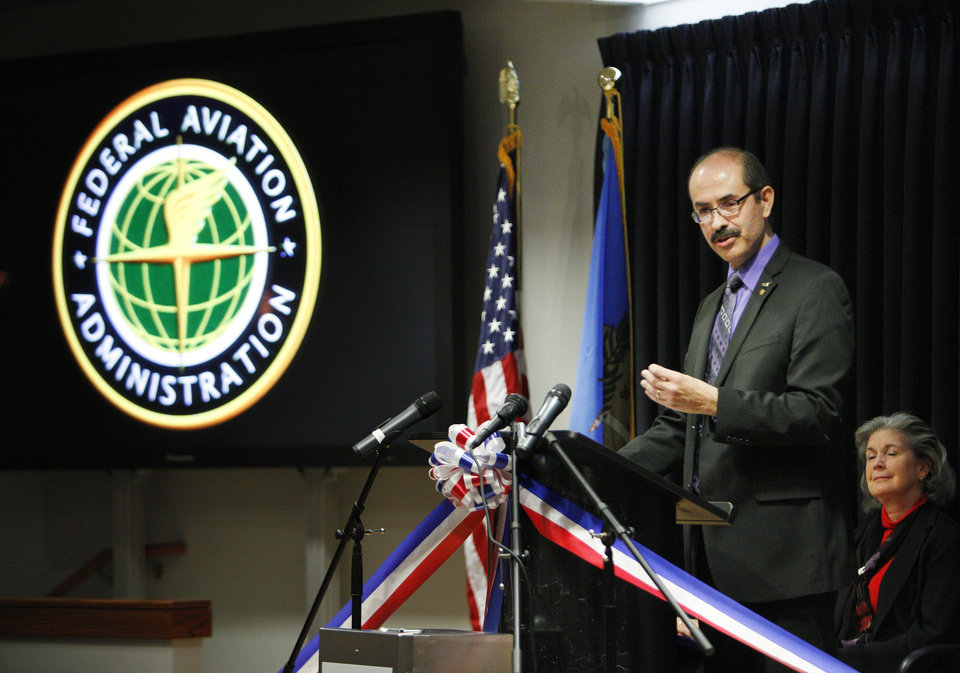 Photo - Dr. Melchor Antunano, director of the FAA'S Civil Aerospace Medical Institute, speaks Wednesday during the 50th anniversary ceremony.