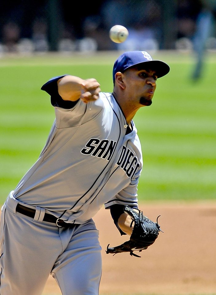 Photo - San Diego Padres starting pitcher Tyson Ross delivers during the first inning of an interleague baseball game against the Chicago White Sox on on Saturday, May 31, 2014, in Chicago. (AP Photo/Matt Marton)