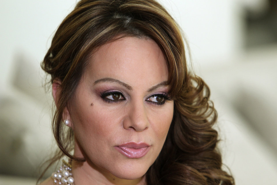 Photo - FILE - In this March 8, 2012 file photo, Mexican-American singer and reality TV star Jenni Rivera poses during an interview in Los Angeles. Las Vegas-based Starwood Management, the company that owns the luxury jet that crashed and killed Rivera on Dec. 9, is under investigation by the U.S. Drug Enforcement Administration, and the agency seized two of its planes earlier this year as part of the ongoing probe. (AP Photo/Reed Saxon, File)