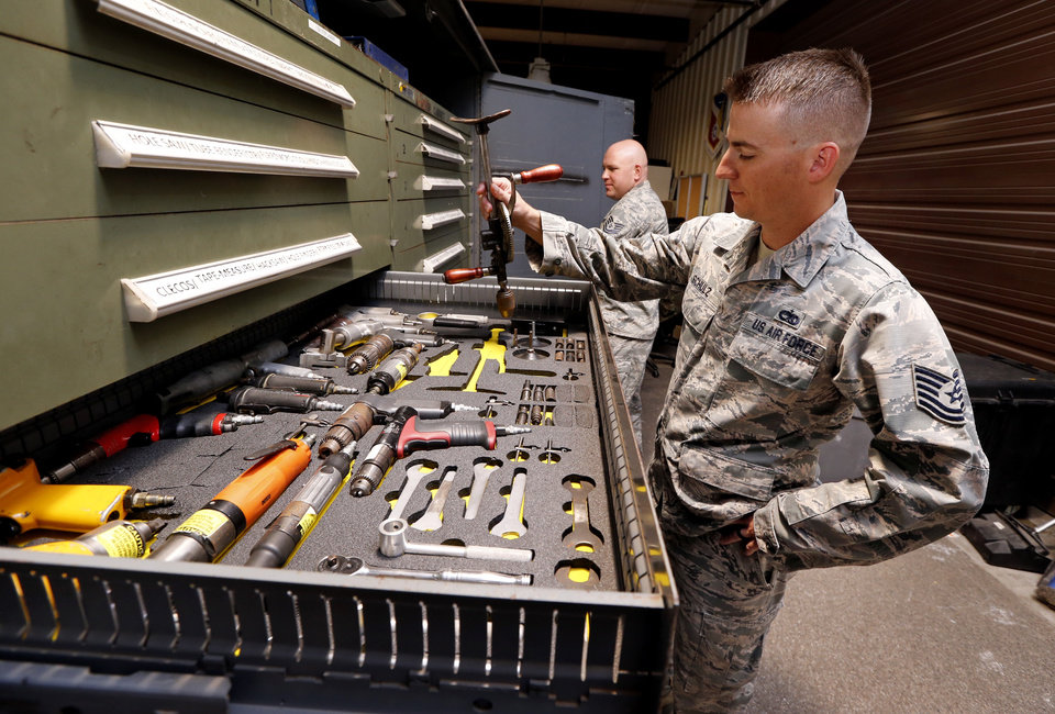 Photo -  Tech. Sgt. Kyle Schulz, with the 76th Expeditionary Depot Maintenance Flight, shows tools in a mobile repair trailer at the APL at Tinker Air Force Base. [Photo by Steve Sisney, The Oklahoman]