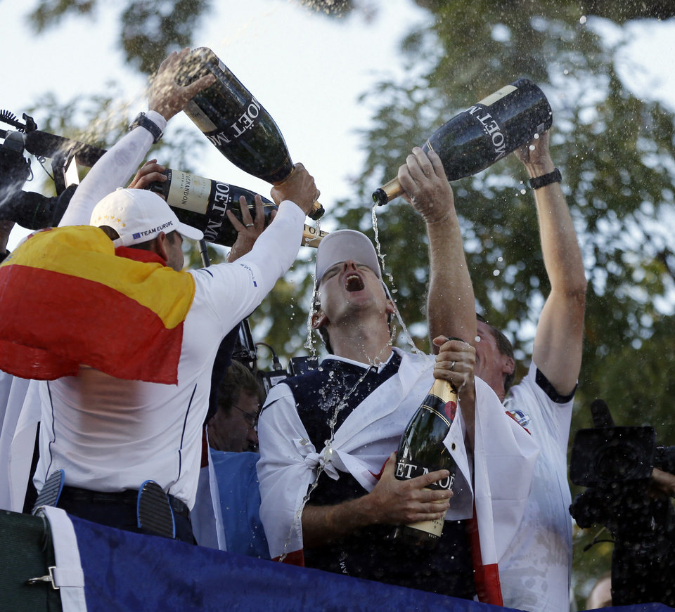 Players pour Champagne on Europe's Justin Rose as the celebrate after winning the Ryder Cup PGA golf tournament Sunday, Sept. 30, 2012, at the Medinah Country Club in Medinah, Ill. (AP Photo/Chris Carlson)  ORG XMIT: PGA222