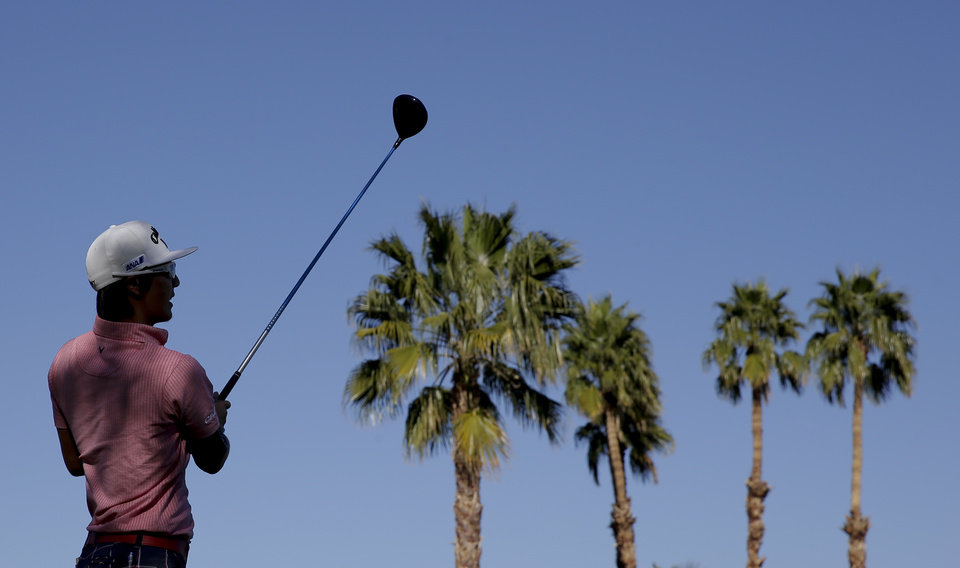Photo - Ryo Ishikawa, of Japan, watches his tee shot the 18th hole during the pro-am portion of the Humana Challenge golf tournament on the Palmer Private course at PGA West on Wednesday, Jan. 15, 2014, in La Quinta, Calif. (AP Photo/Chris Carlson)