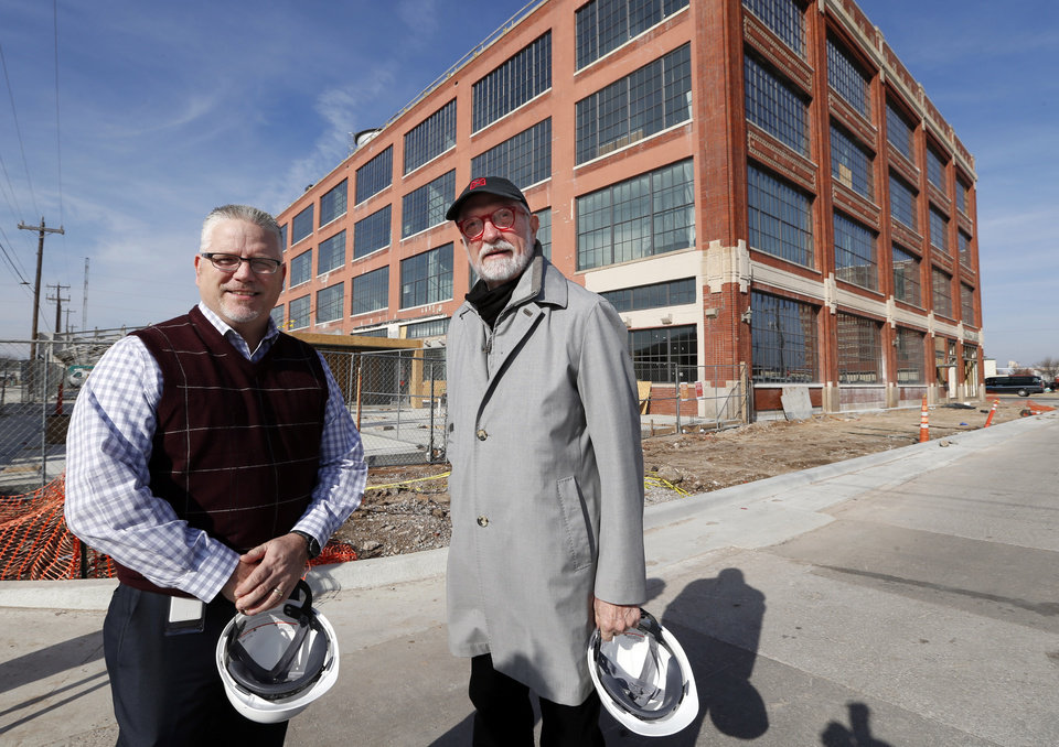 Photo -  Steve Wilson, right, founder of 21c Museum Hotels, and new general manager Matt Cowden at the former Fred Jones Manufacturing site where a new Oklahoma City hotel is under construction on Tuesday, Jan. 5, 2016 in Oklahoma City, Okla. Photo by Steve Sisney, The Oklahoman