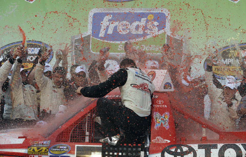 Parker Kligerman celebrates in victory lane at Talladega Superspeedway in Talladega, Ala., Saturday, Oct. 6, 2012, after winning the NASCAR Truck Series auto race. (AP Photo/Rainier Ehrhardt)
