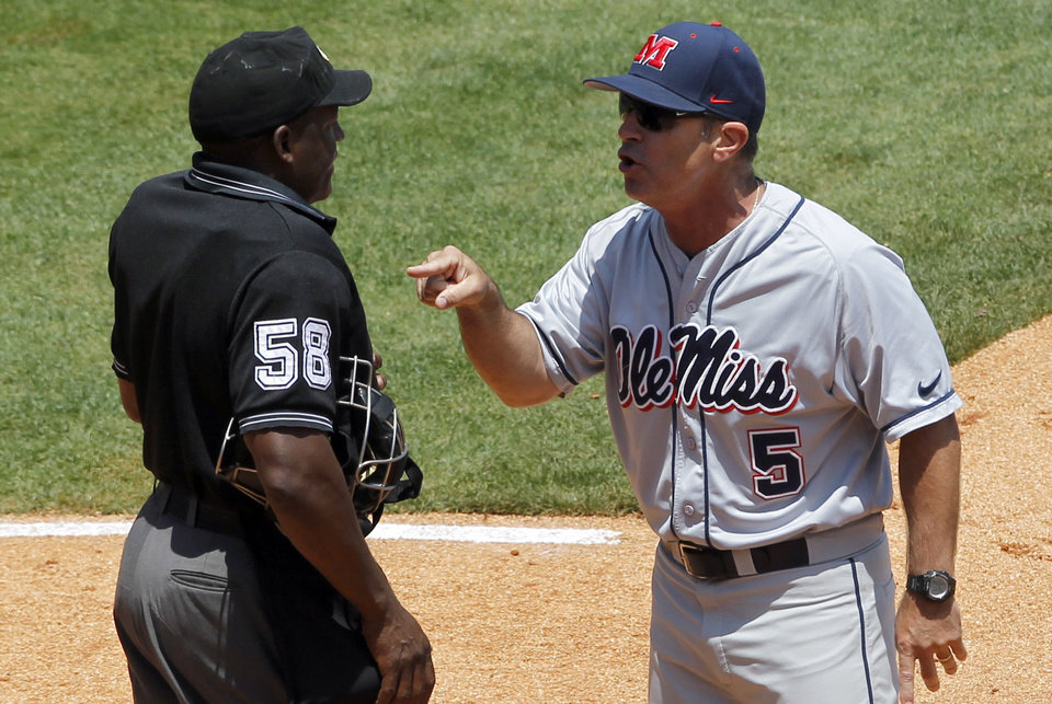 Photo - Mississippi's head coach Mike Bianco argues with umpire David Brown after a call during the seventh inning in a game against Vanderbilt at the Southeastern Conference NCAA college baseball tournament on Thursday, May 22, 2014, in Hoover, Ala. (AP Photo/Butch Dill)