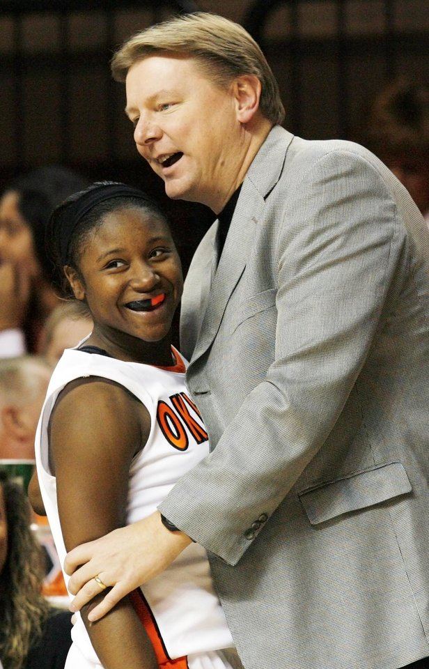 Photo - OSU head coach Kurt Budke talks to Andrea Riley (10) as she leaves the court late in the second half during the women's college basketball game between Oklahoma State University and Mercer at Gallagher-Iba Arena in Stillwater, Okla., Saturday, December 19, 2009. Riley set the OSU record for assists in a game with 17. Photo by Nate Billings, The Oklahoman