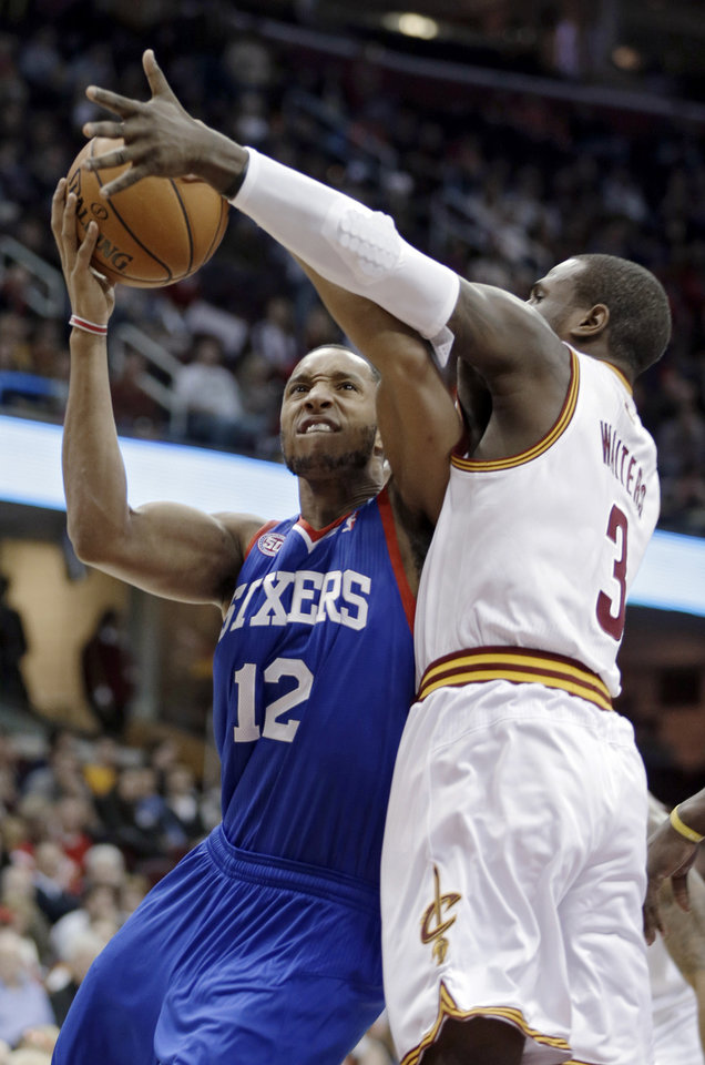 Photo -   Philadelphia 76ers' Evan Turner (12) is fouled by Cleveland Cavaliers' Dion Waiters in the first quarter of an NBA basketball game Wednesday, Nov. 21, 2012, in Cleveland. (AP Photo/Mark Duncan)