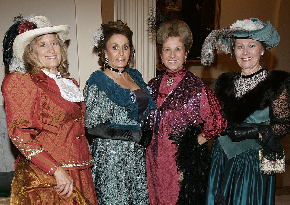 Photo - Fashion was the scene at the Oklahoma Centennial Statehood Inaugural Ball, Saturday, Nov. 17, 2007, at the Guthrie Scottish Rite Masonic Center, in Guthrie, Okla. Pictured in 1900s-period dress are Sharon Fernandez, left, of Spencer, Okla.,  Joyce Sroufe, of Guthrie, (SROUFE-IS CQ), Linda Greenshields, Red Rock, Okla, and Linda Hendren, of Guthrie, right. By Bill Waugh, The Oklahoman ORG XMIT: KOD
