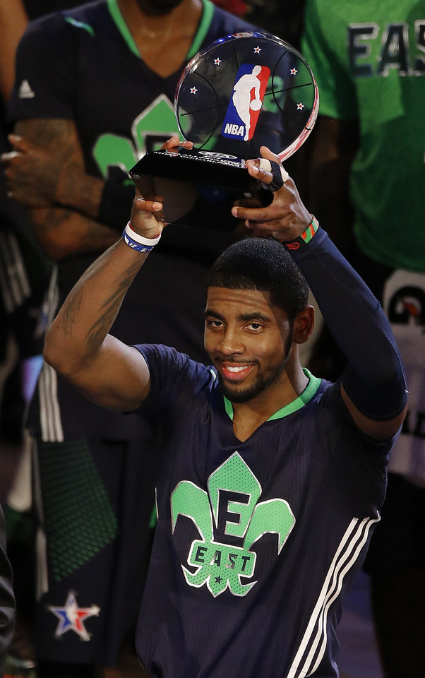 Photo - East Team's Kyrie Irving, of the Cleveland Cavaliers holds the All Star MVP trophy after the NBA All Star basketball game, Sunday, Feb. 16, 2014, in New Orleans.(AP Photo/Bill Haber)